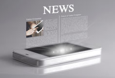 Hot news on 3d screen. Smartphone and tablet reading of newspapers continues to grow rapidly in the future Stock Photo