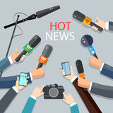 Hot news live report concept. Live news hands of journalists with microphones Stock Photo