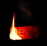 Hot news. Newspaper fire text. Stock Images
