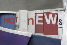 Hot news on newspapers background Royalty Free Stock Image