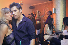 Hot Nightclub Couple. A group of young people are dancing in a nightclub Royalty Free Stock Image
