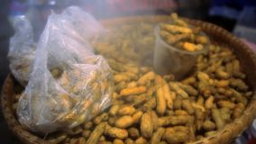 Hot nuts in their skins on a night the Thai market stock video