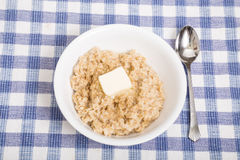 Hot Oatmeal with Butter Stock Photo
