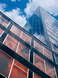 Hot Office. Modern high rise with cloud reflecting facade, Bochum, Northrhine-Westphalia, Germany Stock Image