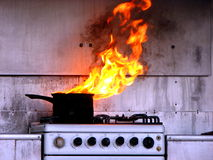Hot Oil Fire in Kitchen. Demonstration of hot oil fire in kitchen by local fire brigade Stock Photo