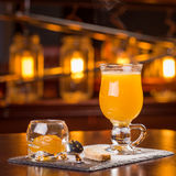 Hot orange cider. Served with jam and cookie on the bar Stock Photos