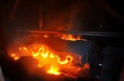 Hot ore on conveyor Royalty Free Stock Photo