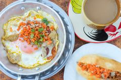 Hot pan fried egg stuff with minced pork and sausage Royalty Free Stock Photos
