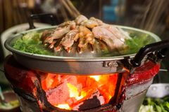 Hot pan grill meat charcoal stove Royalty Free Stock Image