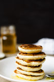 Hot Pancake with honey on white plate Stock Images