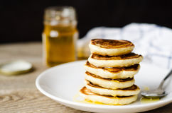 Hot Pancake with honey on white plate Royalty Free Stock Photography