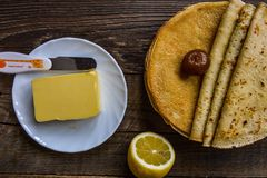 Hot pancakes with butter on wood table Royalty Free Stock Photography