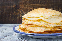 Hot pancakes on the ceramic plate Royalty Free Stock Photo