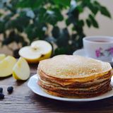 Hot pancakes, fragrant tea and apples Royalty Free Stock Photos