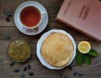 Hot pancakes, fragrant tea and jam Stock Photography