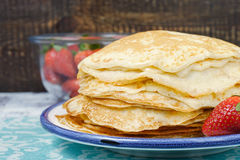 Hot pancakes with strawberries on the ceramic plate Stock Photo