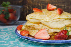 Hot pancakes with strawberries on the ceramic plate Royalty Free Stock Photo