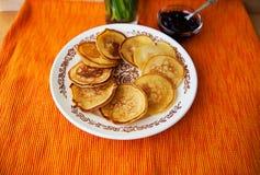 Hot pancakes with strawberry jam on napkin Stock Photo