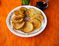 Hot pancakes with strawberry jam on napkin Royalty Free Stock Image