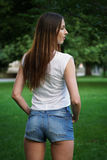 Hot pants or booty shorts fashion trend. Rear view of young woman waering denim hot pants or booty shorts. fashion trend Royalty Free Stock Photography
