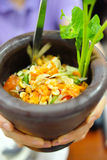 "Hot papaya salad, famous Thai food called. ""Somtum"" served in mortar Stock Image"