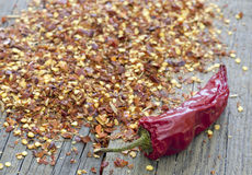 Hot paprika and chili flakes Stock Images