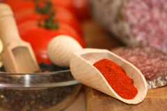 Hot paprika powder in a timber shovel Stock Photos