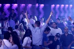 Hot party people in the nightclub (dancehall). Young people are having fun in a nightclub royalty free stock photography