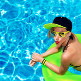 Hot party in the pool. Sexy glamorous lady Stock Photography
