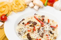Hot pasta with garnish on plate Royalty Free Stock Photography