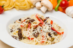 Hot pasta with garnish on plate Royalty Free Stock Photos