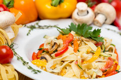 Hot pasta with garnish on plate Stock Photography