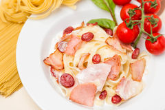 Hot pasta with garnish on plate Royalty Free Stock Photo