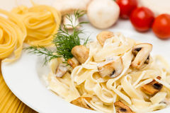 Hot pasta with garnish on plate Royalty Free Stock Image