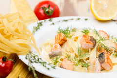 Hot pasta with garnish on plate Royalty Free Stock Images