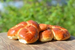 Hot pastries, rolls on table Royalty Free Stock Images