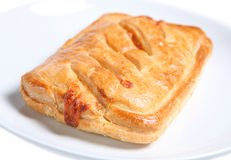 Hot Pastry. Ham and mozzarella baked slice, on white background Stock Photos