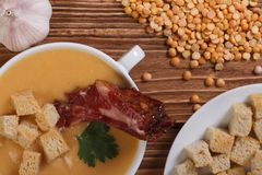 Hot pea soup with smoked meat Royalty Free Stock Photography