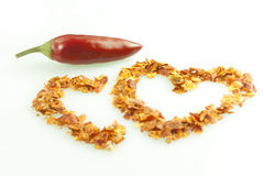 Hot pepper. Dried chili pepper in the shape of the heart Royalty Free Stock Photos