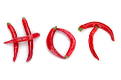 Hot pepper. Fresh hot pepper on the white background make up the word of HOT Stock Photo