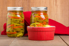 Hot pepper slices canned in mason jars Stock Photos