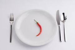 Hot pepper and white china plate Stock Photo