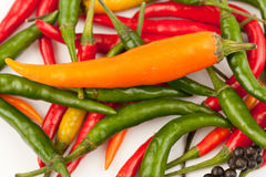 Hot peppers. Red, green, orange and black hot peppers Royalty Free Stock Photography