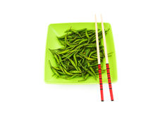 Hot peppers with chopsticks Stock Image