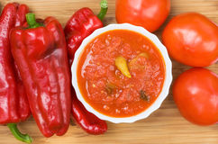 Hot peppers in tomato sauce with herbs and garlic Stock Images