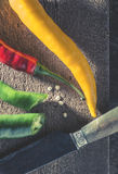 Hot peppers on wooden cutting board Stock Images