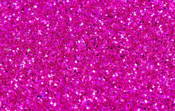 Hot pink abstract background. Pink glitter closeup photo. Pink shimmer wrapping paper. Sparkling glitter festive backgrop. Valentine day greeting card or Royalty Free Stock Images