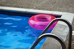Bright pink inflatable pool ring. Bright pink toy in swimming pool Stock Photography