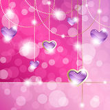 Hot pink sparkly banner with heart-shaped pendants. Elegant romance-themed background with gemstone pendants. Graphics are grouped and in several layers for easy Royalty Free Stock Images