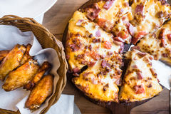 Hot Pizza ham and Chick wings BBQ. stock photos
